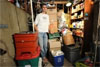 AFP – Dave Chameides poses with his trash for 2008, in the basement of his home in Los Angeles, California(AFP/Robyn …