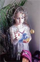 Buy this photo   Ruby Rickard, 4, of Columbia plays withcrystal balls in the window of The Stone Power Earth Shoppe.
