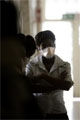 AFP/File Photo: A nurse at the Sizwe hospital TB ward in Edenvale on the outskirt of Johannesburg,...