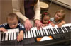 Wicked Local Photo by Nicole Goodhue Boyd Meredith Roman Pizzi, a certified music therapist, plays the keyboard with help from 19-month-old Nick Vicente, 1-and-a-half year old Leila Contin, and 2-year-old Sydney Ball during a developmental music therapy program called 'Sprouting Melodies' on Tuesday, April 27