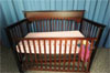 AP Photo/CPSC This undated handout photo provided by the Consumer Product Safety Commission (CPSC) shows a Simplicity crib. The government recalled thousands of Simplicity and Graco cribs Thursday, warning that babies could suffocate or strangle in them.
