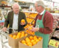Jim McGuire of Peru talks to Hy-Vee produce clerk Roger Zehr recently about oranges. Eating right doesn't always have to be complicated. By including a few simple, readily-available foods consistently in your diet, you'll be on the road to better health. NewsTribune photo/Kemp Smith